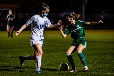 Chazy's Ava McAuliffe looks to dribble the ball past Seton defender Elizabeth Manion