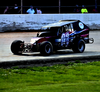 Mike Houghtailing(03) wins in the DIRT Modified Nostalgia Tour A Main