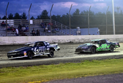 Jason McClatchie (70) wins over Shawn Duquette (18) in the Hartson Total Opening Renegades A Main