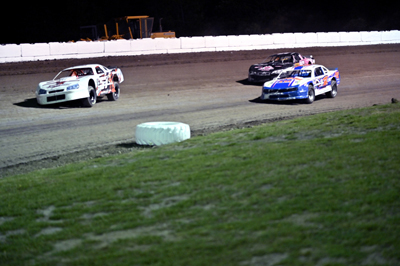 Kevin Featherly(57K) leads Justin White(1) & Tyler Bushey (#15) in the Pro Stock A Main