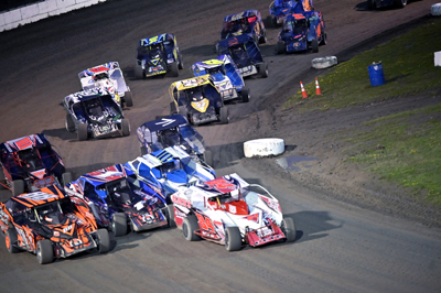 Joshua Pete (84P) leads the pack on turns 3 and 4 in the Crossroads Tobacco Sportsman Modifieds A Ma