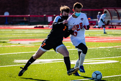 Plattsburgh's Simon Meyer and Beekmantown's Dalton Kane fight for the ball